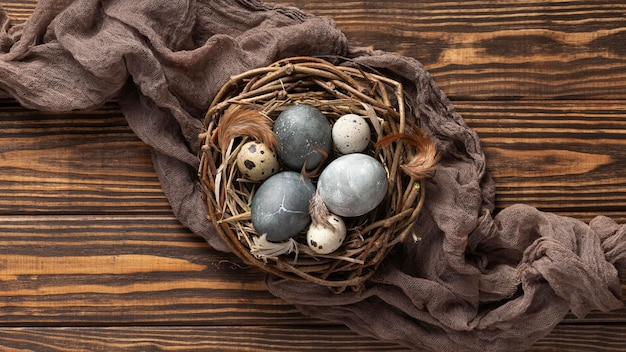 Top view of eggs for easter with fabric and bird nest