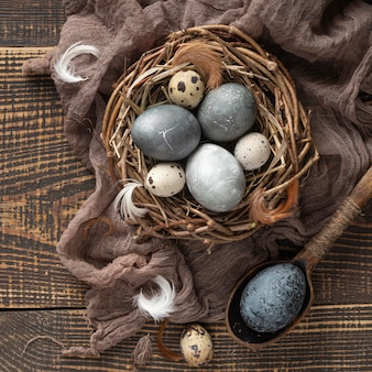 Top view of eggs for easter with textile and bird nest