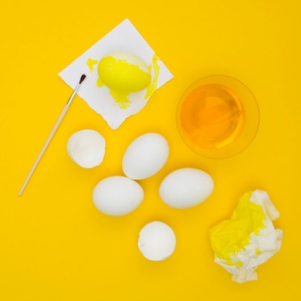 Top view of eggs for easter with yellow paint