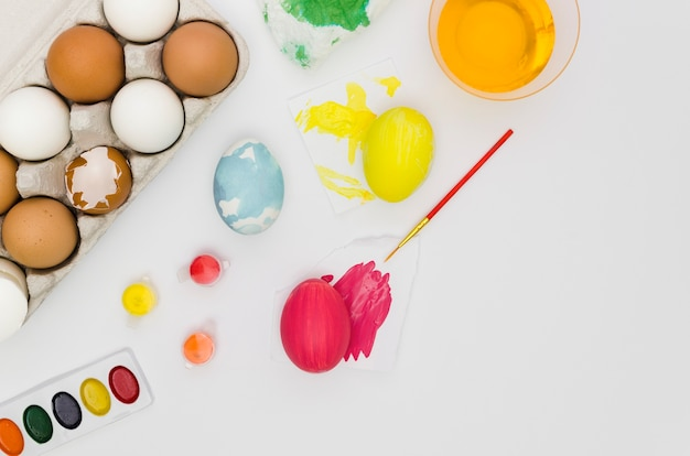 Top view of eggs with paint for easter