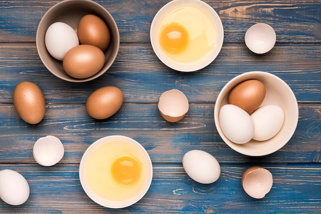 Top view eggs on wooden background