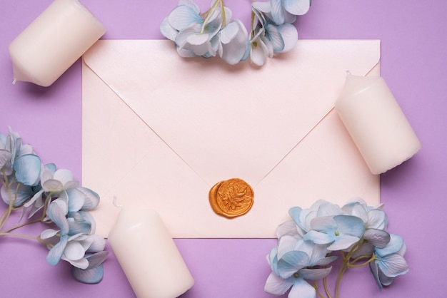 Top view elegant envelope with wedding candles