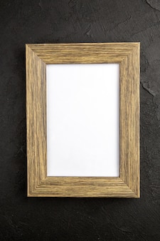 Top view elegant picture frame on dark-gray background gift present love photo portrait color family