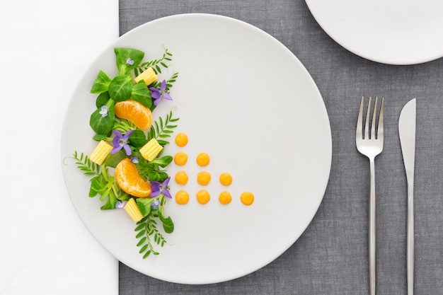 Top view elegant plate with cutlery