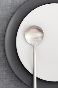 Top view elegant plates with spoon