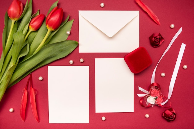 Top view elegant wedding invitation with flowers