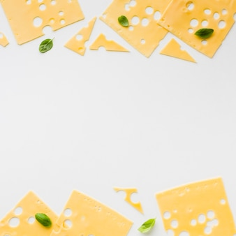 Top view emmental cheese slices with copy spaces