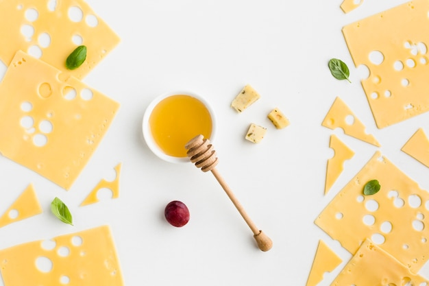 Top view emmental cheese slices with honey