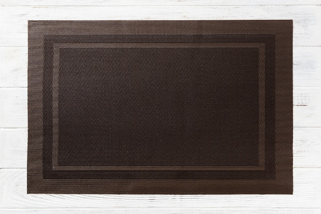 Top view of empty brown table napkin for dinner on wooden