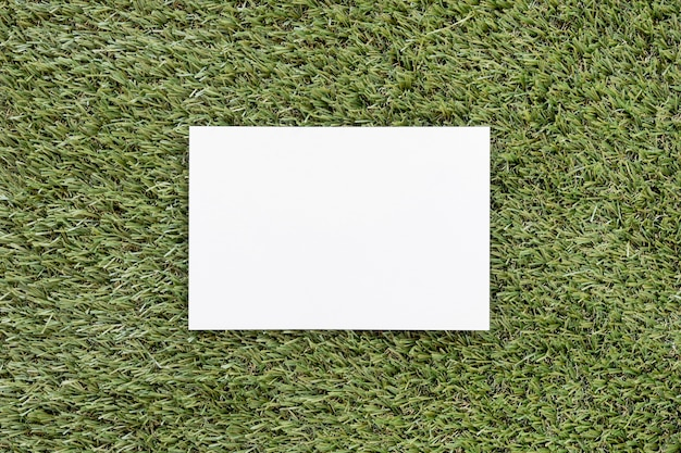 Top view empty card on green grass