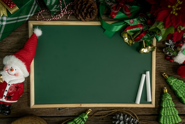 Top view, empty chalkboard decoration with gift box and lights on christmas day