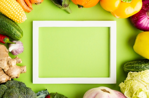 Top view empty frame with arrangement of vegetables