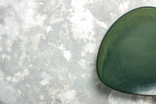 Top view empty green plate isolated on light grey desk.