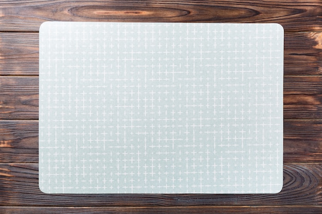 Top view of empty green table napkin for dinner on wooden
