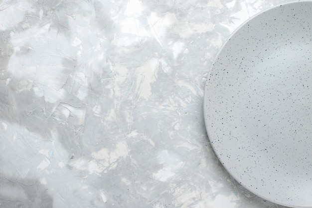Top view of empty grey plate on light, plate kitchen cutlery