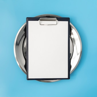 Top view of empty menu on metal plate