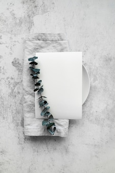 Top view of empty menu paper on plate with leaves