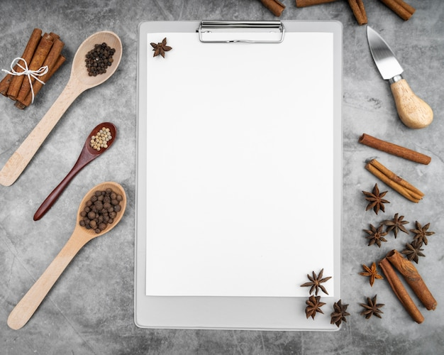 Top view of empty menu with cinnamon sticks and star anise