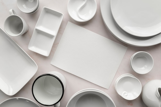 Top view of empty menu with white dishes