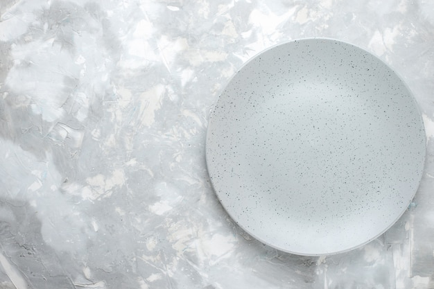 Top view of empty plate grey round formed on light, plate kitchen