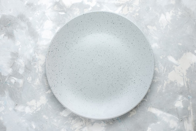 Top view of empty plate round formed on light, plate kitchen