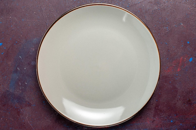 Top view empty round plate glass made grey plate on dark surface