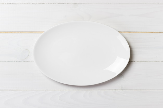 Top view of empty white food plate