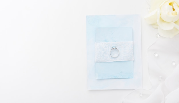 Top view engagement ring on wedding card