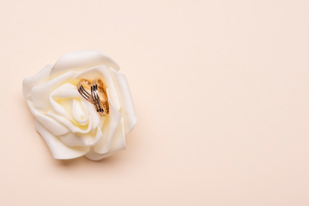 Top view engagement rings on flower