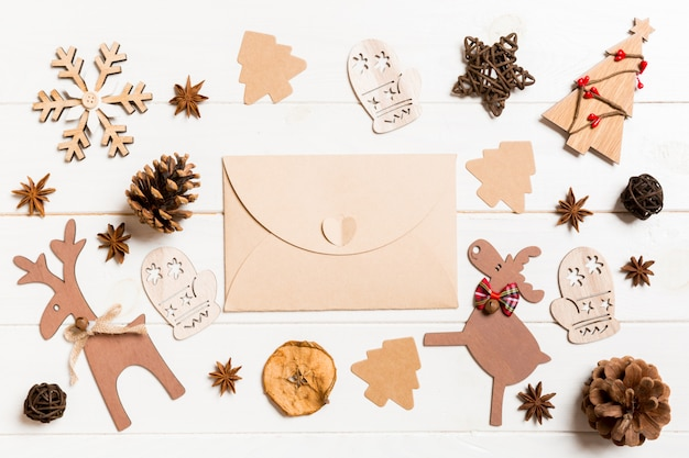Top view of envelope on festive wooden.