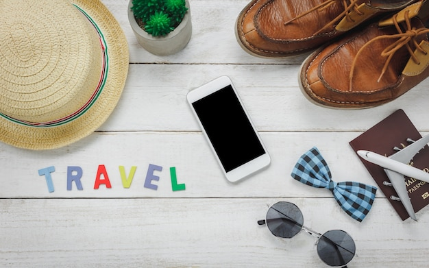 Top view essential accessories to travel.the items travel concept with with word