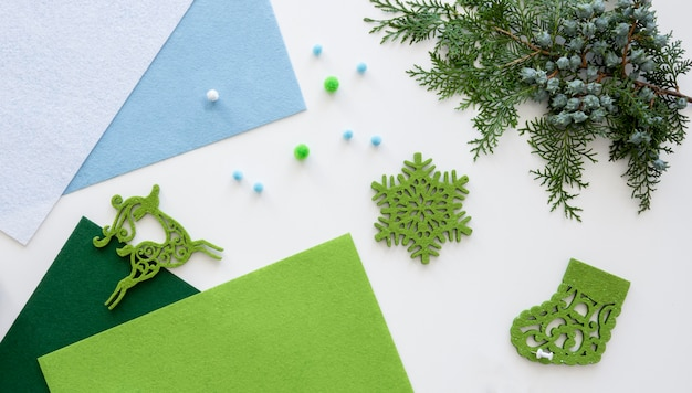 Top view of essentials for crafting christmas gift with paper and plant