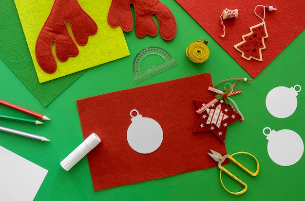 Top view of essentials for crafting christmas gift with paper and tape measurer
