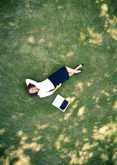 Top view of executive resting on the grass