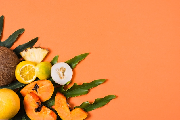 Top view exotic fruits on the table with copy space