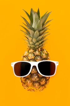 Top view exotic pineapple with sunglasses