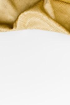 Вид сверху ткани золотой текстуры с копией пространства