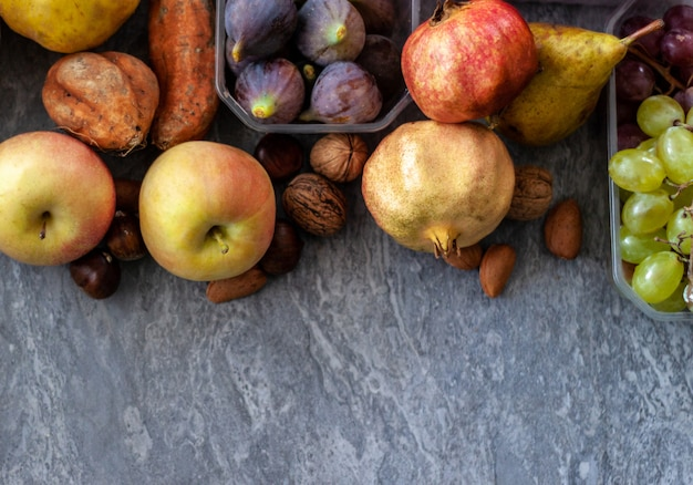 Top view of fall fruits over grey surface