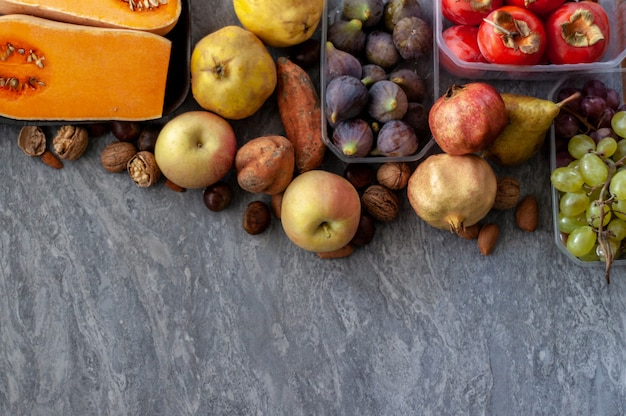 Top view to fall fruits with copy space.