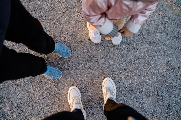 Top view of family legs on the ground outdoors. bonding time together. simple things. high quality photo