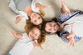 Top view family portrait laying on carpet