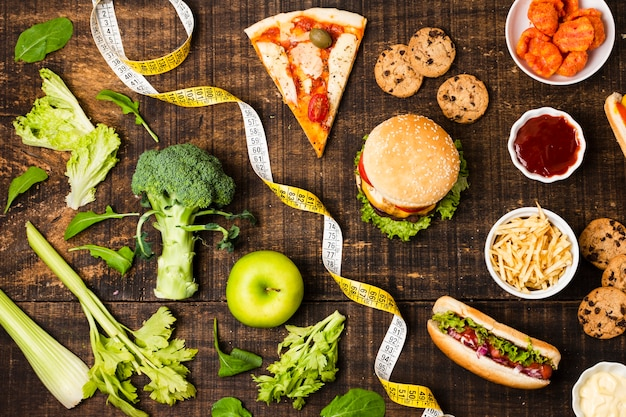 Top view of fast food and vegetables