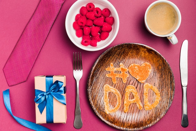 Top view father's day concept with dessert and gift