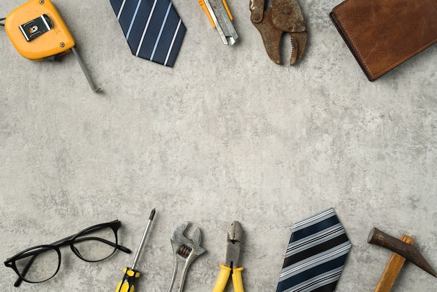 Top view of fathers day and labor day concept with working tools on blue background.
