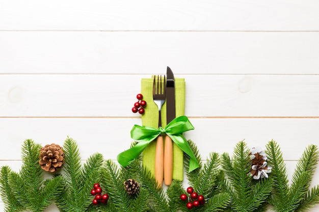 Top view of festive cutlery on new year wooden background. christmas decorations with empty space . holiday dinner