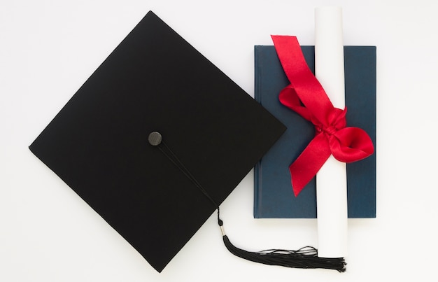 Top view festive graduation arrangement with academic cap