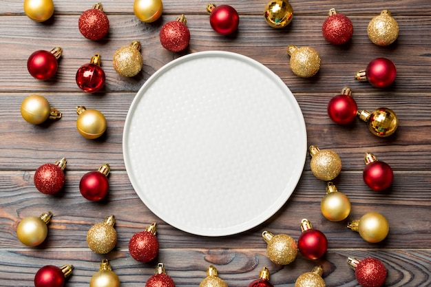 Top view of festive plate with red and golden baubles