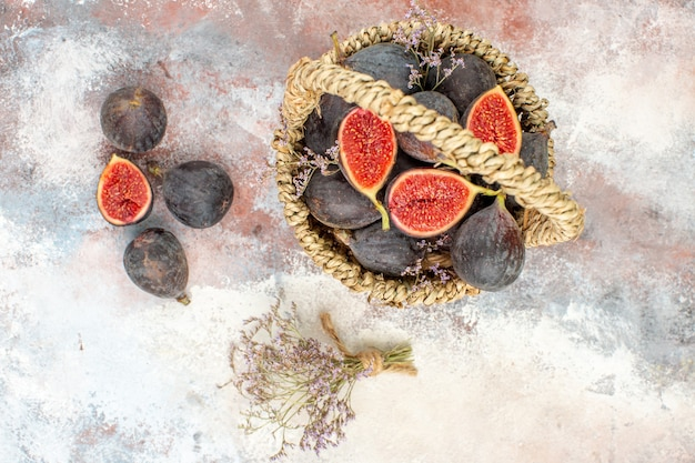 Top view fig basket figs dried flower bunch on grey background