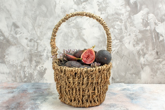 Top view fig basket on grey background