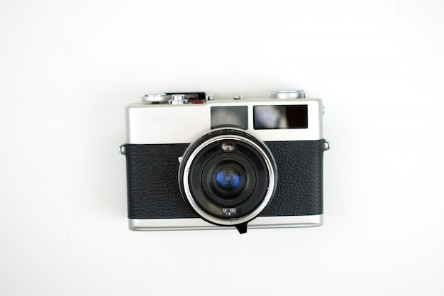 The top view of a film camera on a white . isolated .
